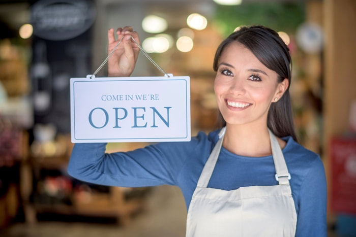 woman-open-for-business-sign